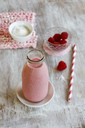 Glass bottle of raspberry smoothie - EVGF03349