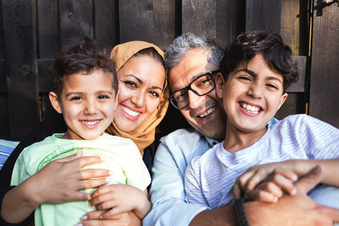 Portrait of happy family outside house - MASF02982