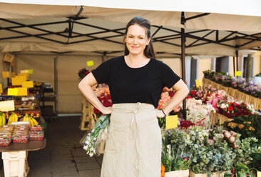 Portrait of confident female owner standing at flower shop - MASF02985