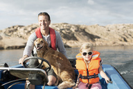 Man driving motorboat with daughter and dog in Baltic Sea - MASF03031