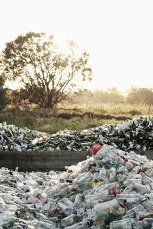 Heap of bottles for recycling at field - MASF03064