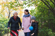 Happy senior woman with daughter and great grandson in park - MASF03073