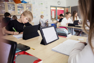 High school students learning through digital tablets in classroom - MASF03106