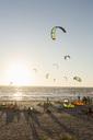 Kiteboarders on beach against sky on sunny day - MASF03112