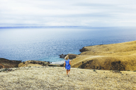 High angle view of woman walking at Blowhole Beach against sea and sky - CAVF36518