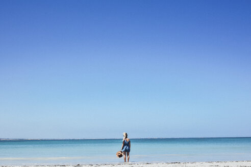 Rear view of woman at Port Fairy against clear blue sky - CAVF36548