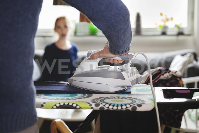 Cropped image of man ironing clothes at home - MASF03137