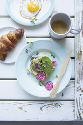 Directly above shot of open sandwich with avocado and radish during breakfast - MASF03158