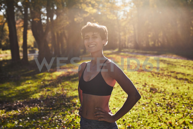Mid adult woman at forest glade during training - SHOF00031