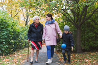 Full length of senior woman walking with daughter and great grandson in park - MASF03192