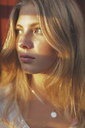 Close-up of sunlight falling on teenage girl - MASF03246