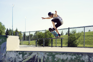 Young man skateboarding on railing - CAVF36998