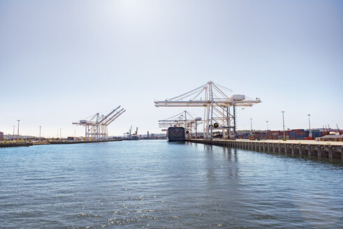 Scenic view of commercial dock at sea against sky - CAVF37502