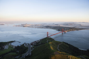 Aerial view of Golden Gate Bridge over San Francisco Bay during sunset - CAVF37514