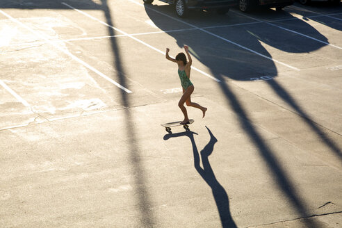 High angle view of woman skateboarding in skateboard park - CAVF37802