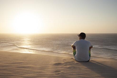 Man sitting on beach - CAVF37955