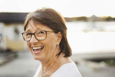 Portrait of confident senior woman smiling outdoors - MASF03396