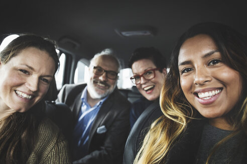 Portrait of happy people sitting in new car at showroom - MASF03414