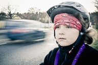 Little girl wearing bandana and cycling helmet looking away - MASF03531