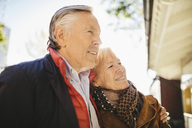 Happy senior couple standing outside musical theater - MASF03567
