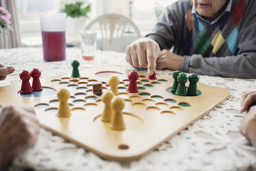 Cropped image of people playing Ludo in nursing home - MASF03693