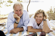 Close up portrait of smiling couple at picnic - MASF03711