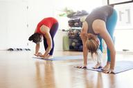 Women performing yoga in gym - CAVF38067