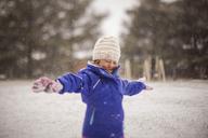 Happy girl enjoying snow - CAVF38287
