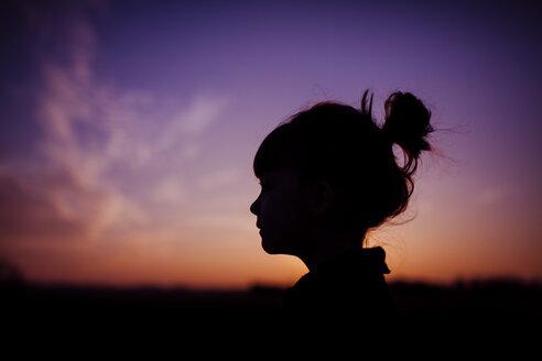 Silhouette girl against dramatic sky during sunset - CAVF38293