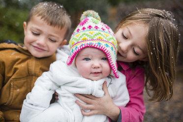 Portrait of cute baby girl with siblings at backyard - CAVF38440