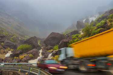 Spain, Canary Islands, Gran Canaria, Veneguera, truck and car on mountain pass at waterfall Los Azulejos - FRF00649