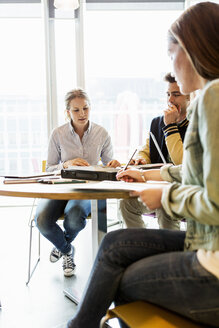 Woman sitting with friends in university classroom - MASF03772