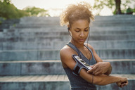 Woman using smart phone armband while exercising - MASF03781
