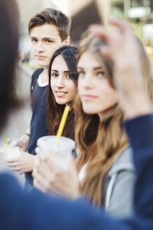 Teenagers looking at friend outdoors - MASF03901