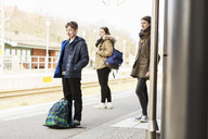 School students waiting for train at station - MASF04003