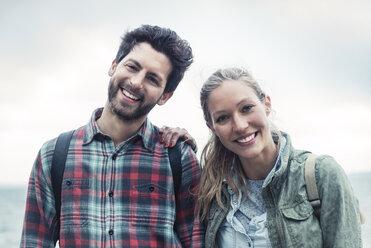 Portrait of happy wonderlust couple standing against sky - MASF04093