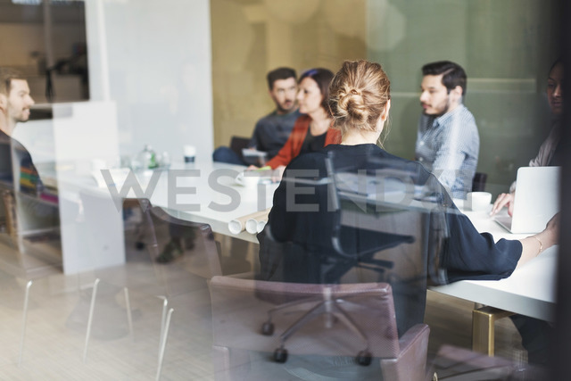 Multi-ethnic business people discussion on project in meeting room - MASF04129