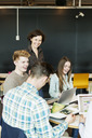 Happy professor training students in university classroom - MASF04230