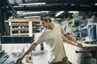 Carpenter making furniture at workshop - MASF04356