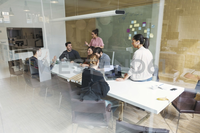 Creative team of business people having discussion in conference room - MASF04368