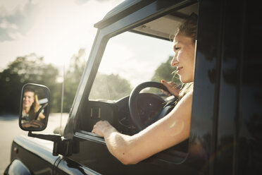 Cropped image of woman looking away while driving car - MASF04383