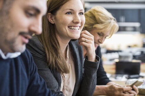 Smiling businesswoman looking away in office meeting - MASF04500