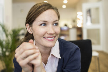 Smiling businesswoman looking away in office - MASF04503