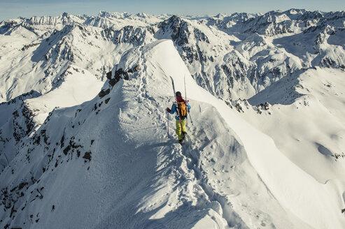 Skier walking on snowcapped mountain - MASF04539