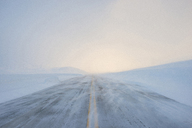 View of snow covered road against sky during foggy weather - CAVF38669