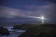 Scenic view of Yaquina Head Lighthouse on shore against star field - CAVF38696