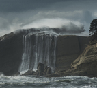 Low angle view of waterfall against stormy clouds at Cape Kiwanda State Park - CAVF38699