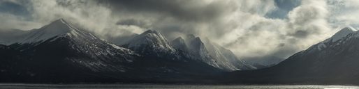 Panoramic view of mountains against cloudy sky - CAVF38702