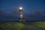 Tranquil view of illuminated lighthouse against sky during night - CAVF38729