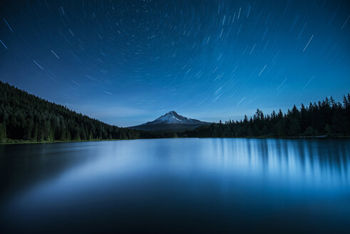 Majestic view of Trillium Lake by Mt Hood against Star Trails during night - CAVF38738